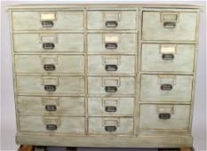 Antique French hardware store cabinet