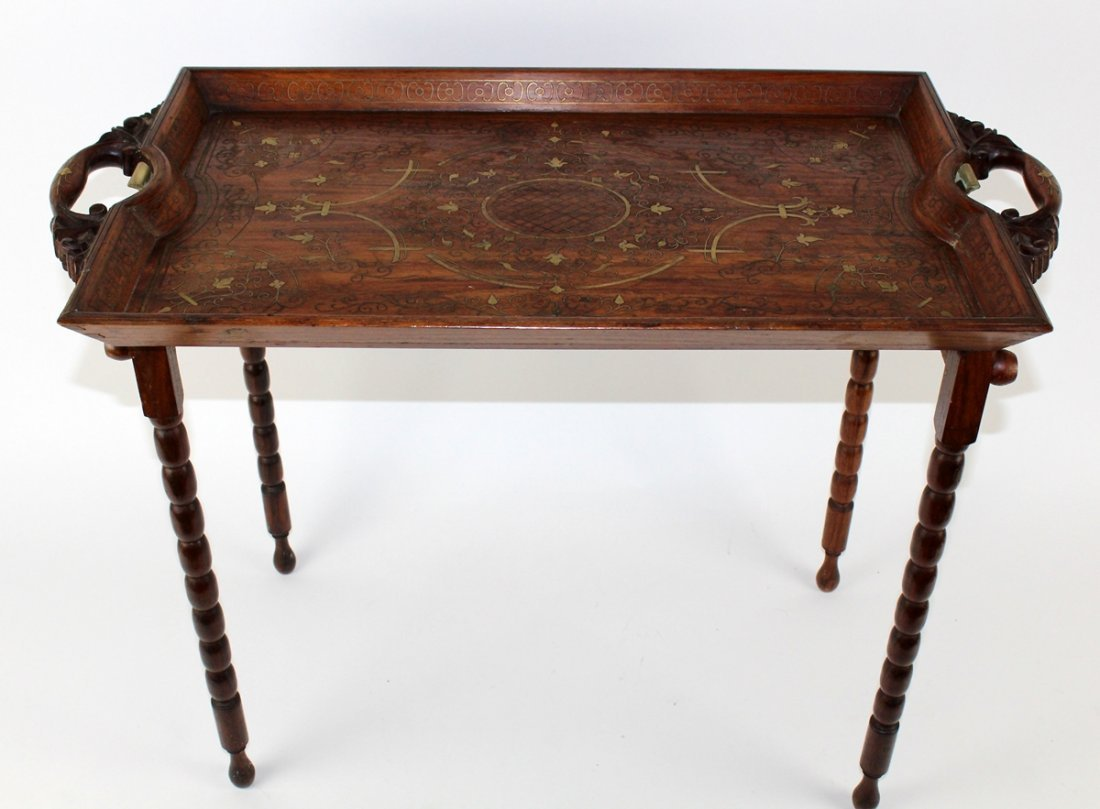 Rosewood butlers table with ornate brass inlay