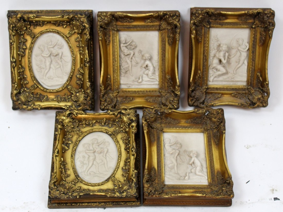Grouping of 5 cast relief cherub plaques