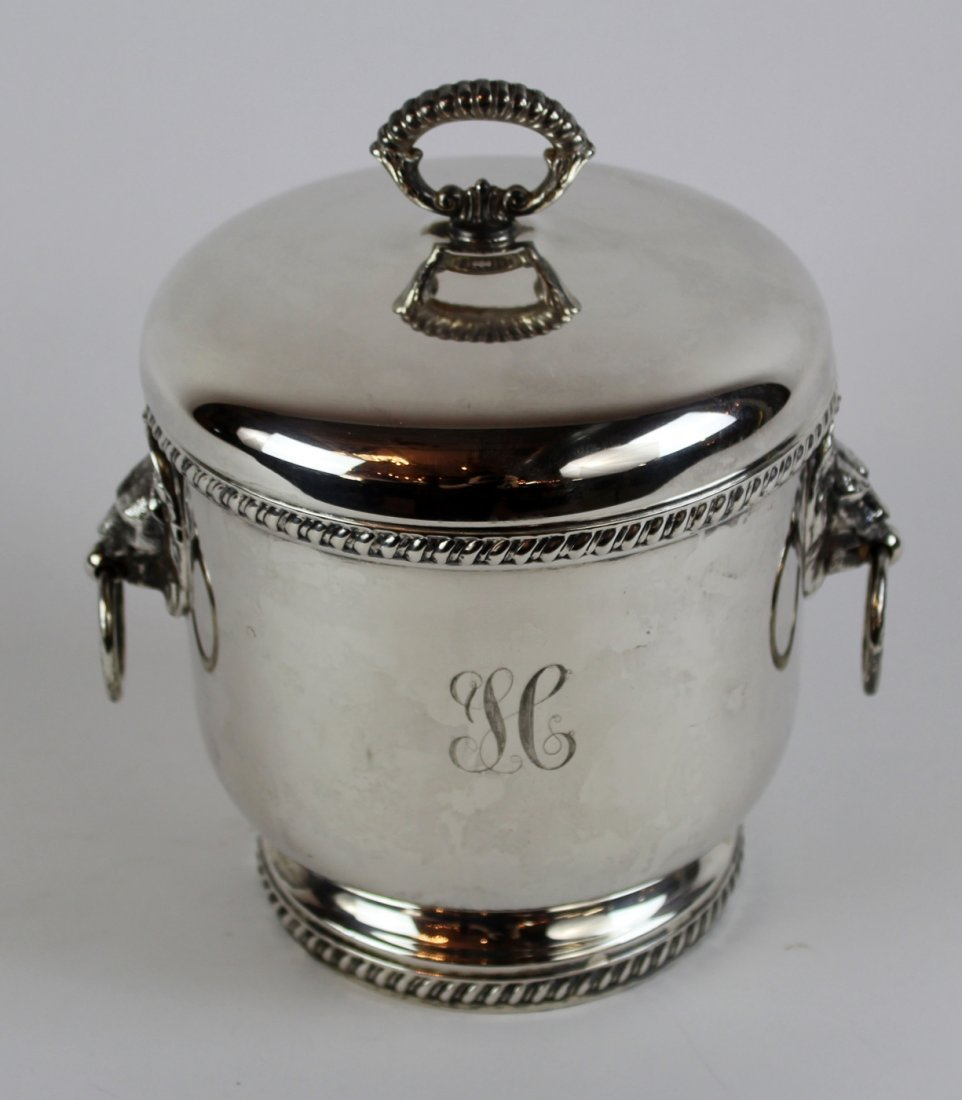 Silverplate ice bucket with lion head handles