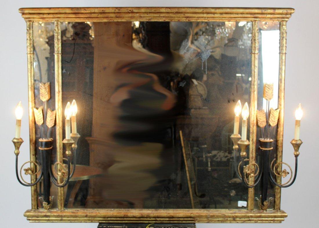 Decorative gilt framed mirror with sconces
