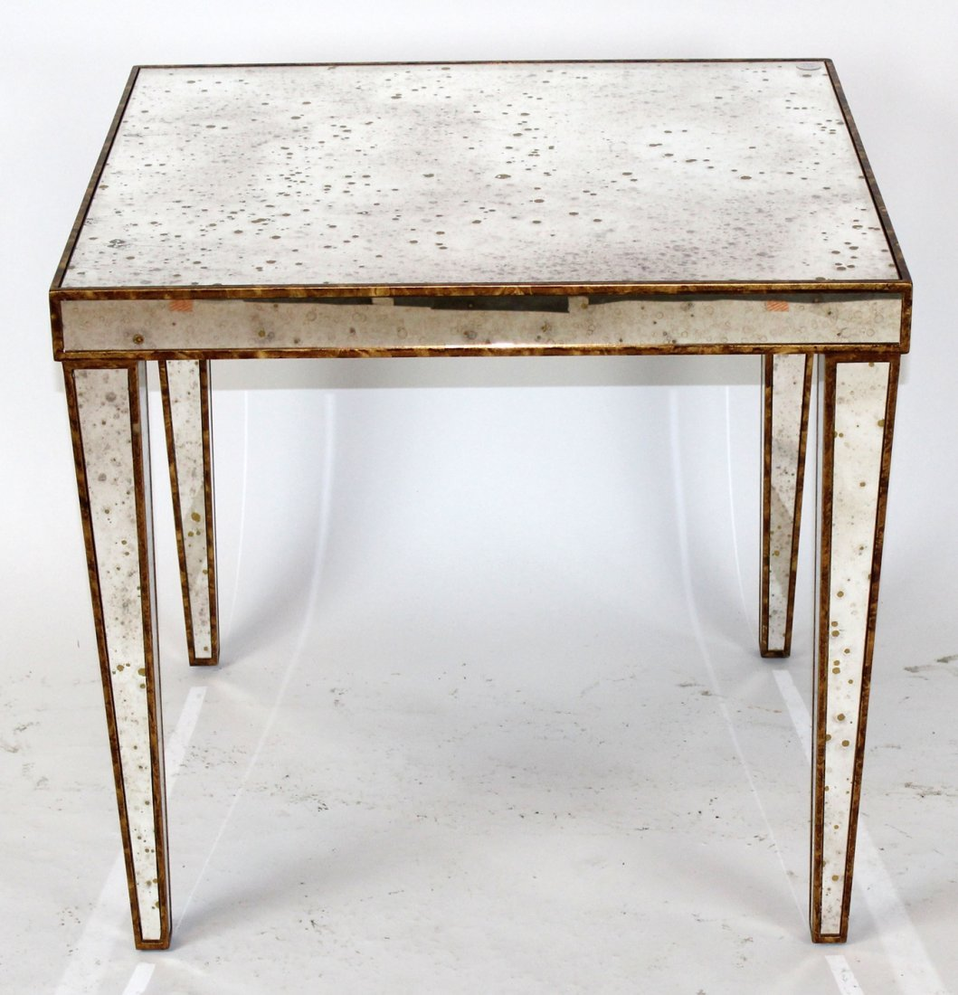 Square mirrored accent table with gilt detail