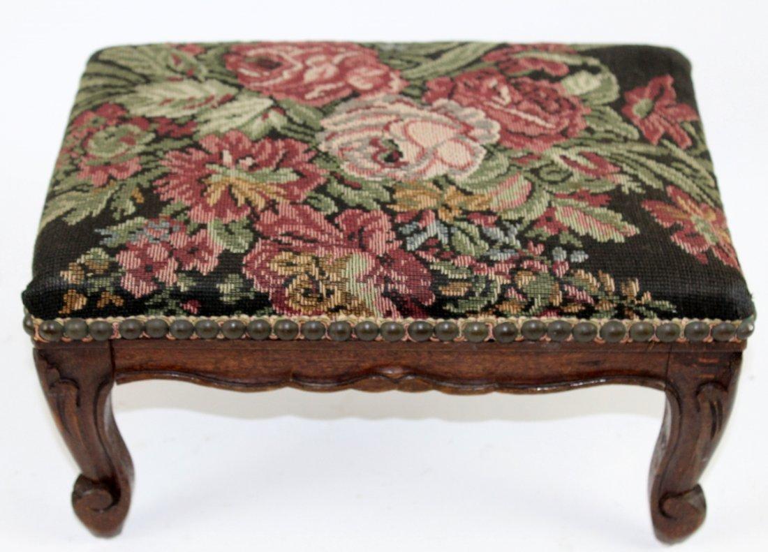 Needlepoint upholstered footstool