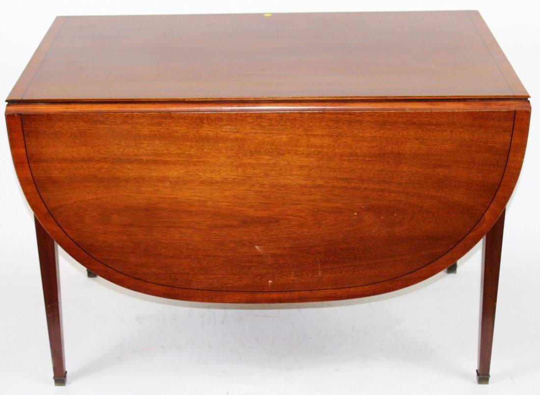 Mahogany drop leaf table on tapered legs