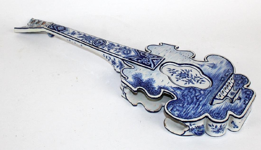 Delft porcelain string instrument form wall planter
