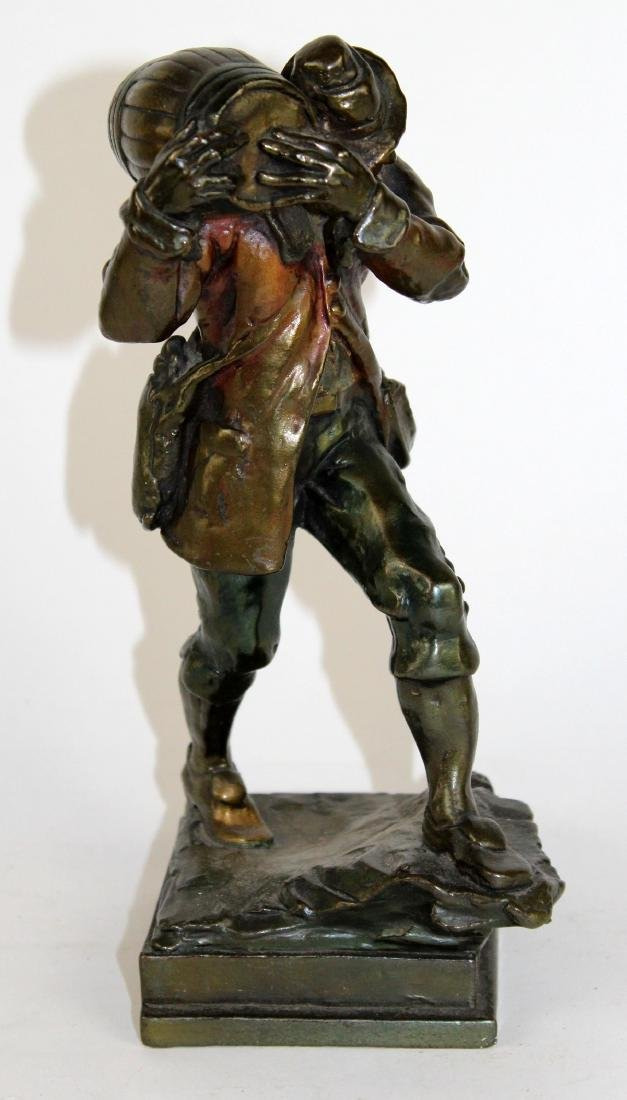 Bronze clad statue of Prohibition man with keg