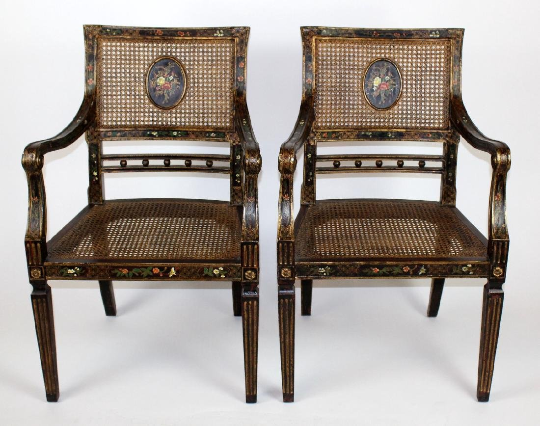 Pair of painted caned armchairs