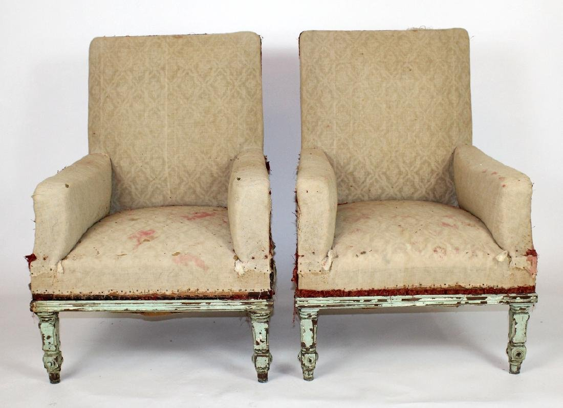 Pair of French armchairs covered in muslin.
