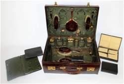 Art Deco men's traveling grooming kit in alligator case