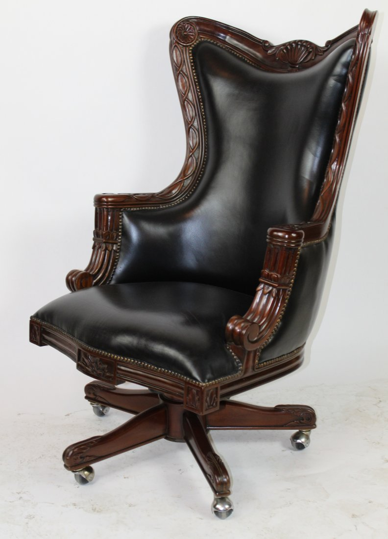 Carved mahogany swivel desk chair with leather