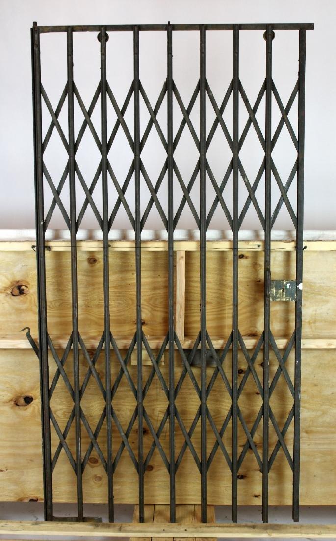 French iron accordion style elevator door