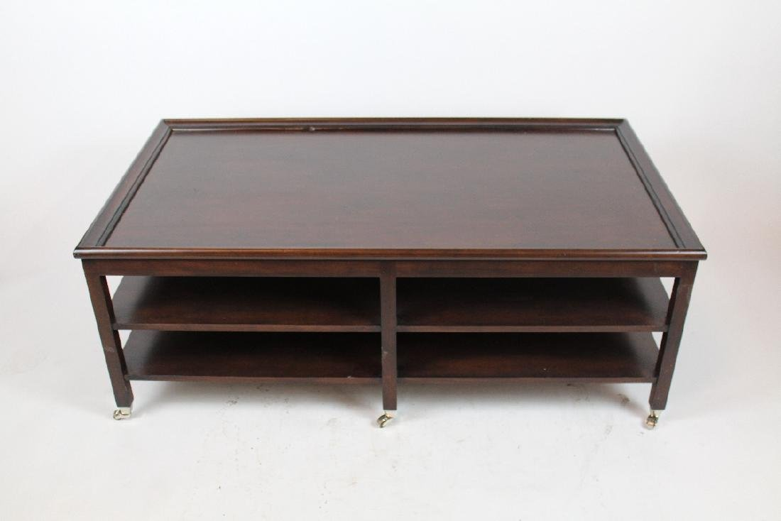 Mahogany 2-tier cocktail table on casters