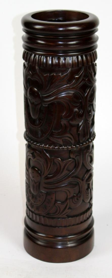 Heavily carved mahogany umbrella stand