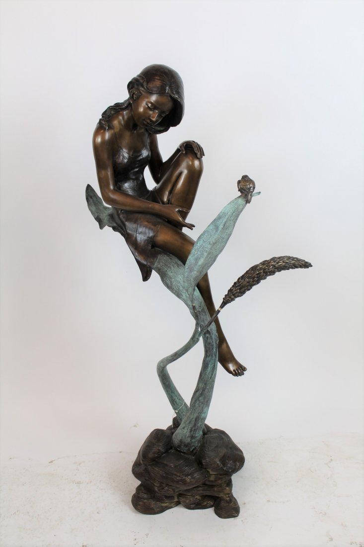Bronze sculpture young girl on leaf with bird