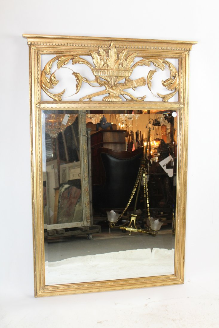 Louis XVI style gilt beveled mirror
