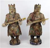Pair of carved wooden warrior statues