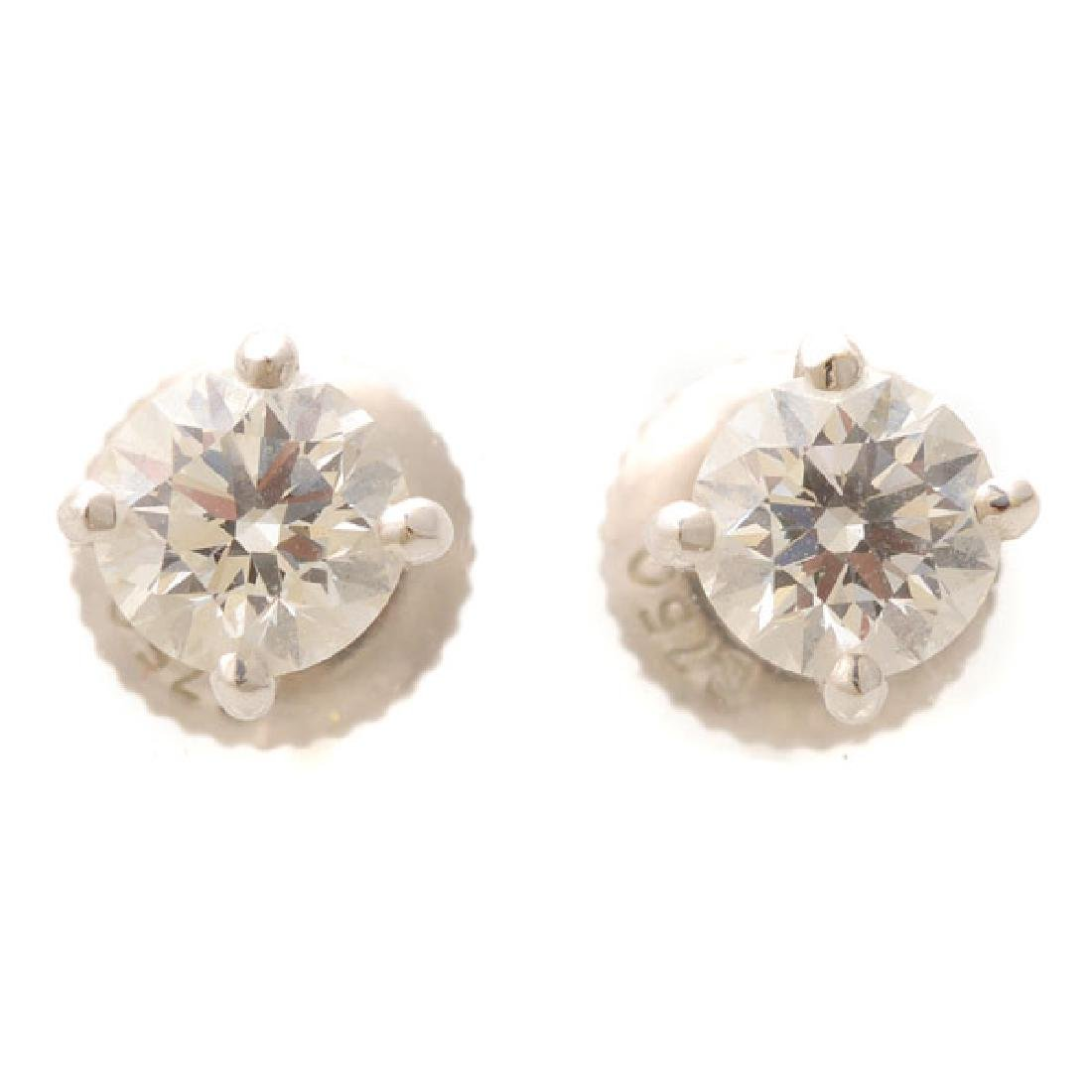 Pair of Diamond, 18k White Gold Stud Earrings.