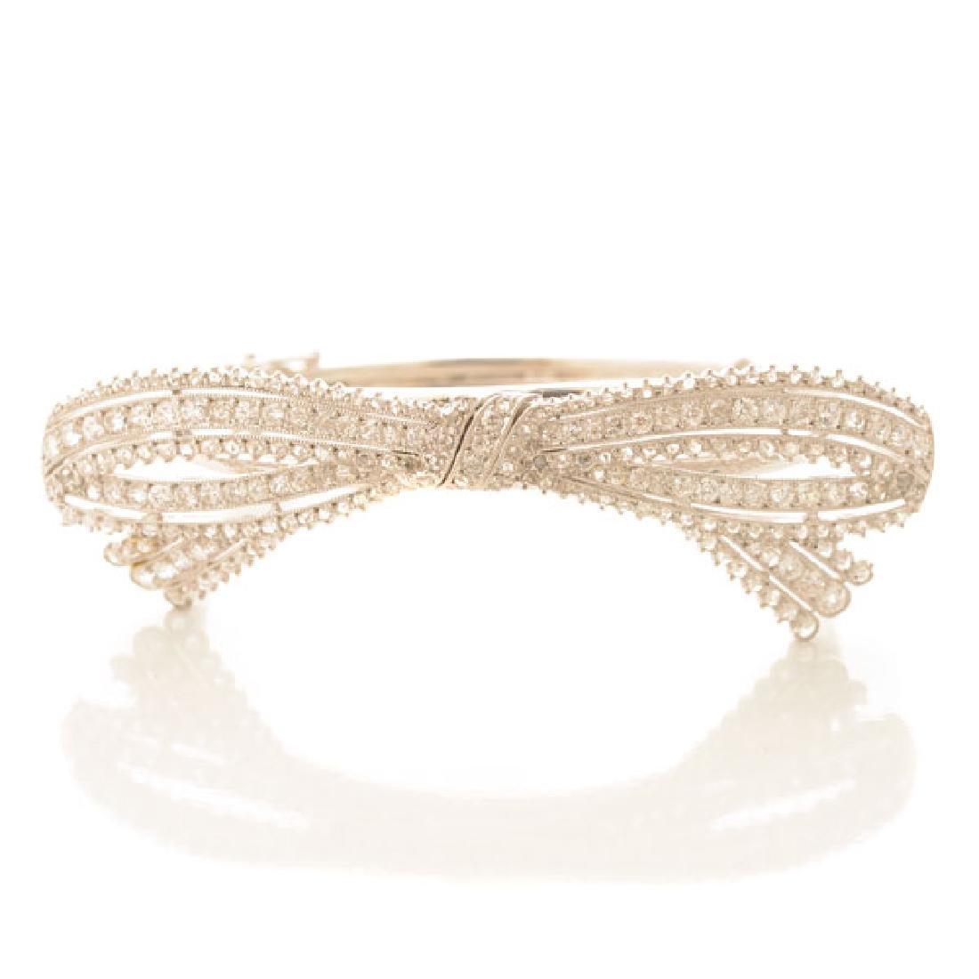 Diamond, Platinum Bow Bracelet.