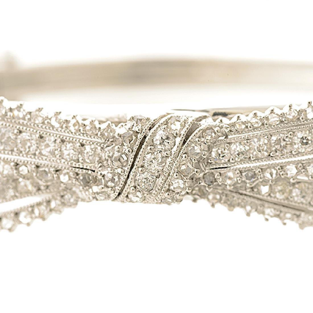 Diamond, Platinum Bow Bracelet. - 2