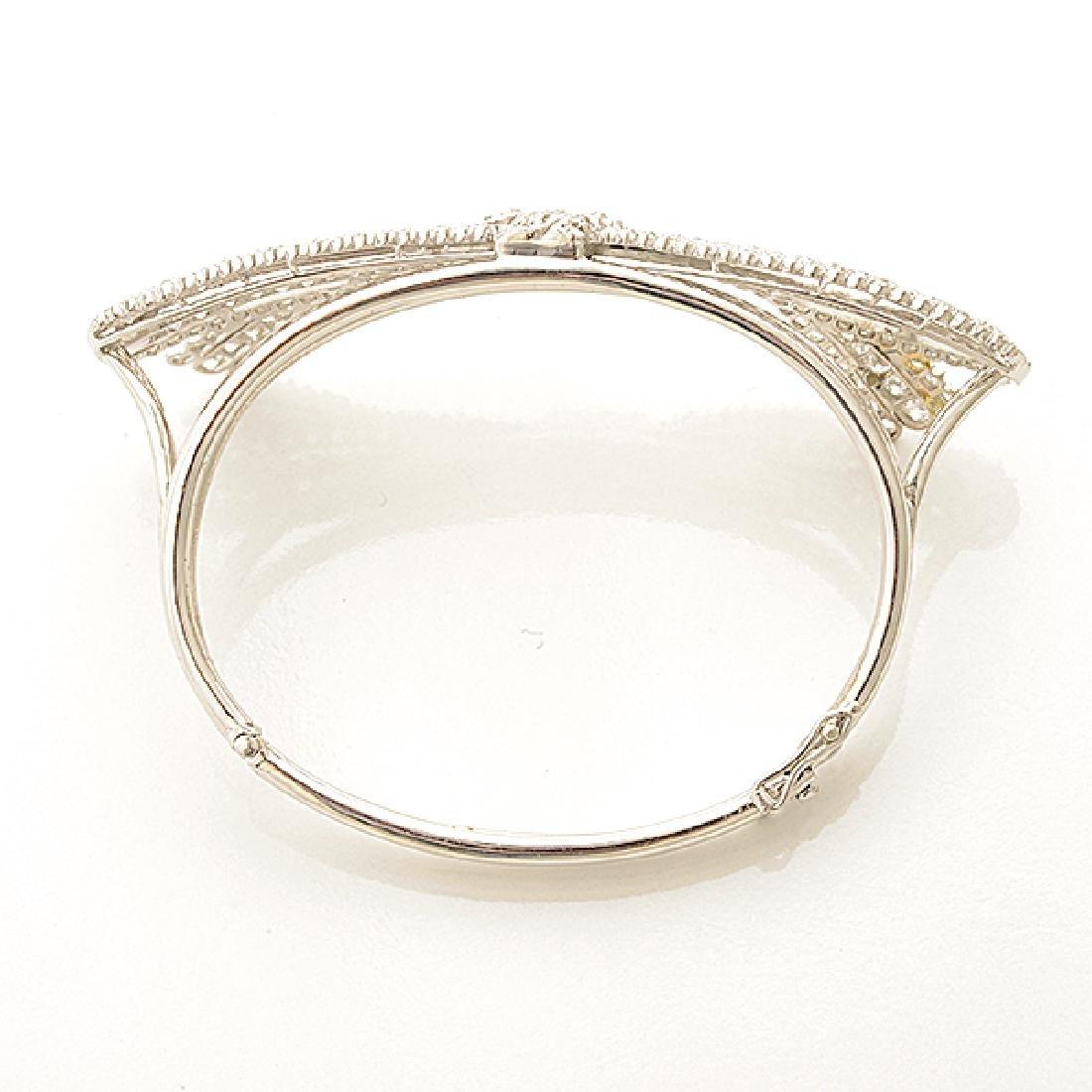 Diamond, Platinum Bow Bracelet. - 3
