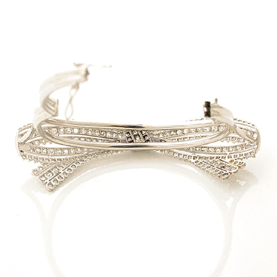 Diamond, Platinum Bow Bracelet. - 4