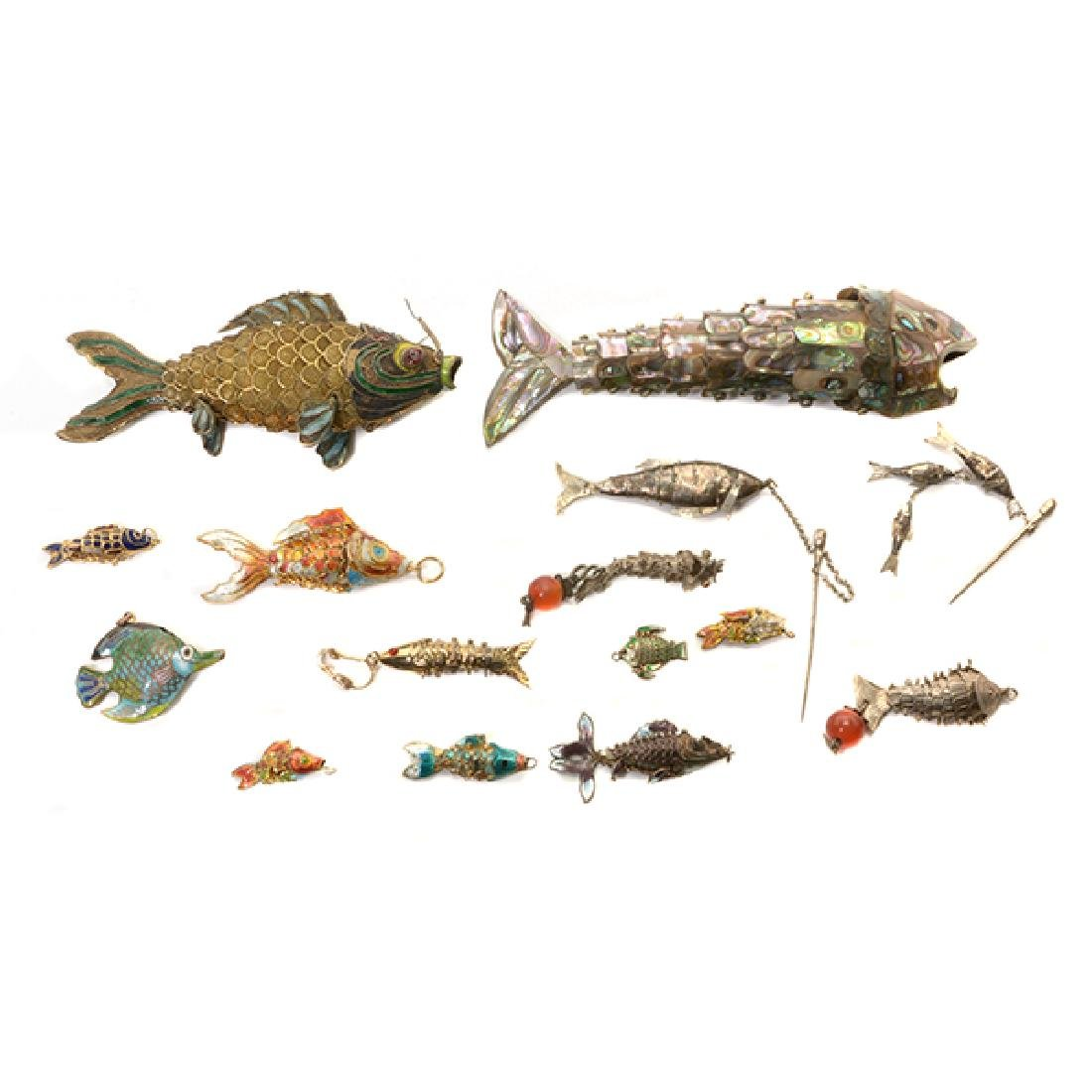A Group of Mostly Silver Fish Models