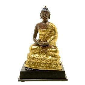 A Repousse Gilt Bronze Figure of Buddha, Mongolian,