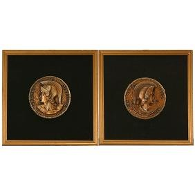 Two Composition Bronze Plaques on Black Velvet