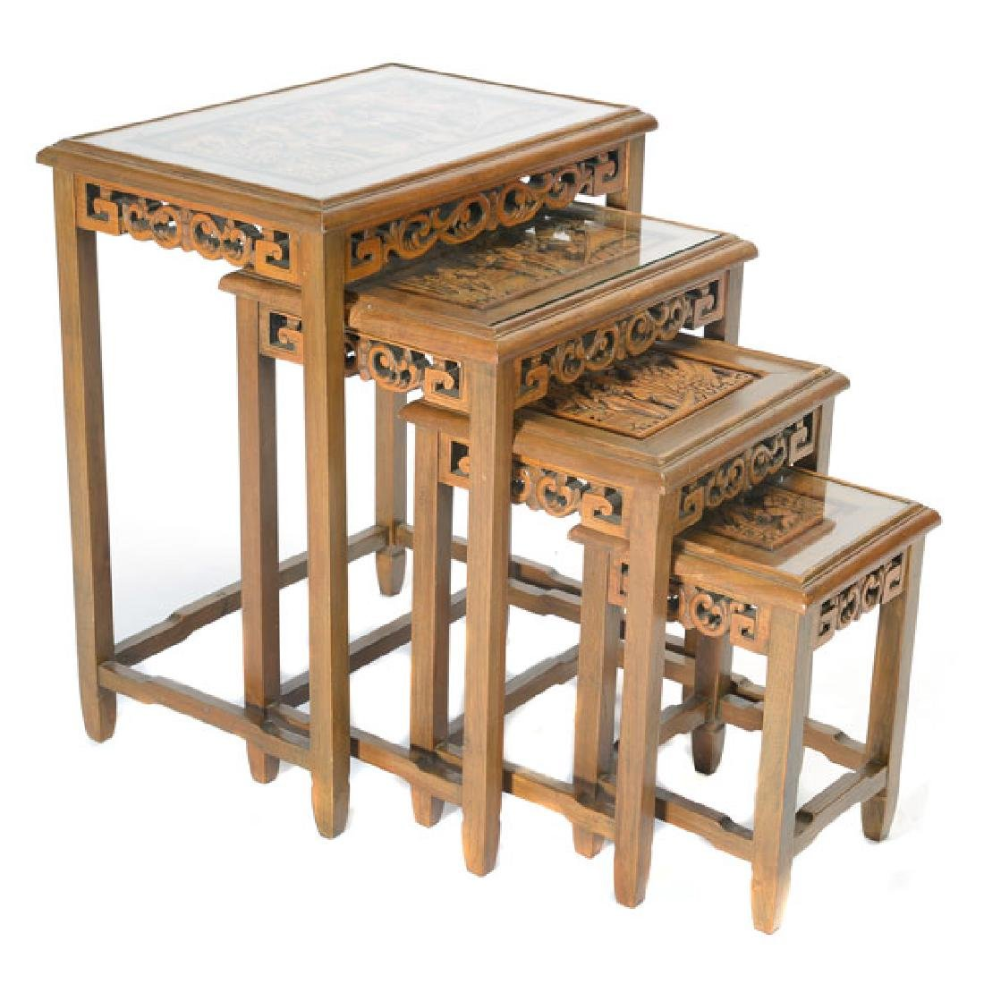 Set of Four Nesting Tables with Carved Figural