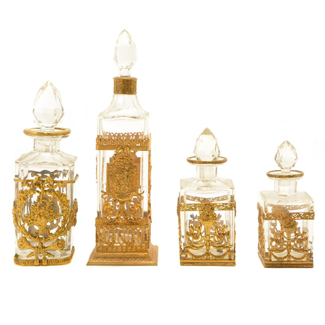 Collection of Eight Gilt Bronze Mounted Glass Bottles