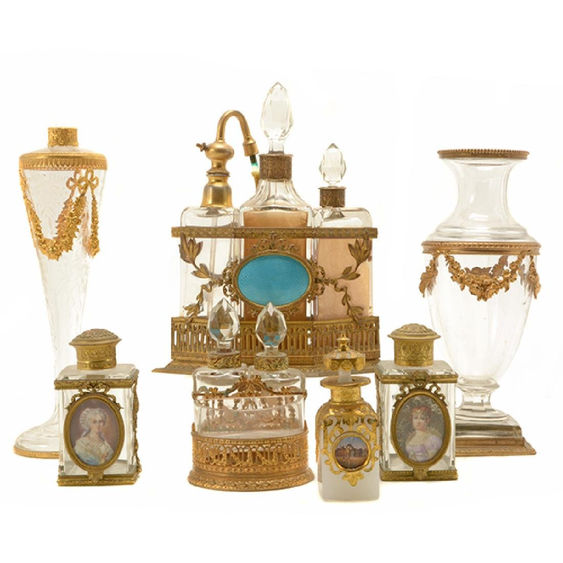 Collection of Nine Gilt Bronze Mounted Glass Bottles