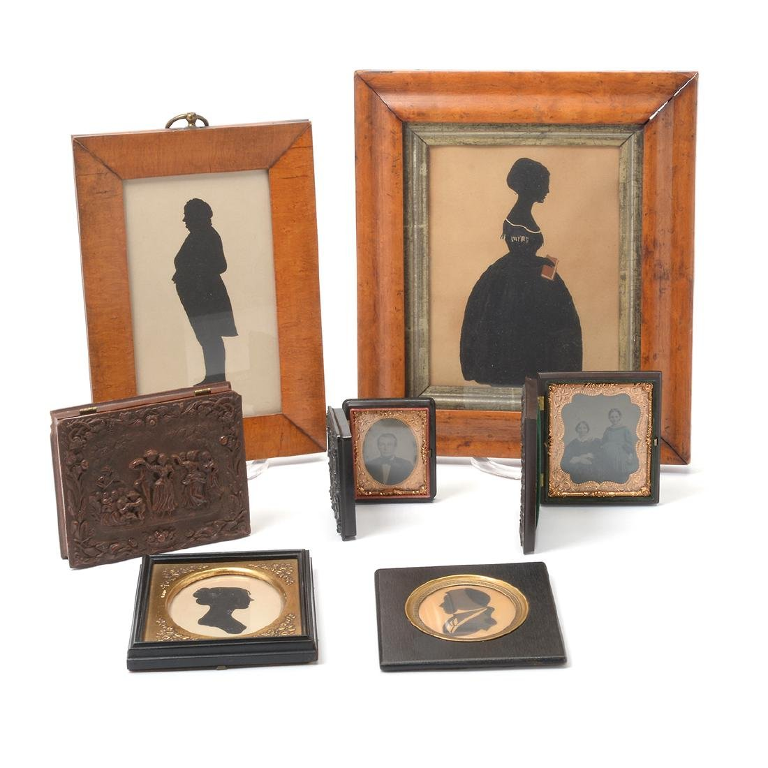 Four Silhouettes (Two of Figural Form in Maple Frames);