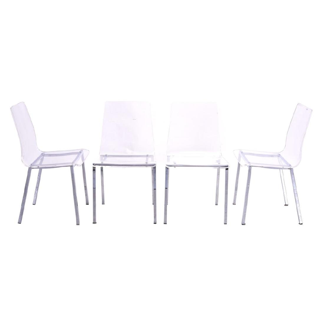 Four Modernist Style Clear Plastic Side Chairs, with