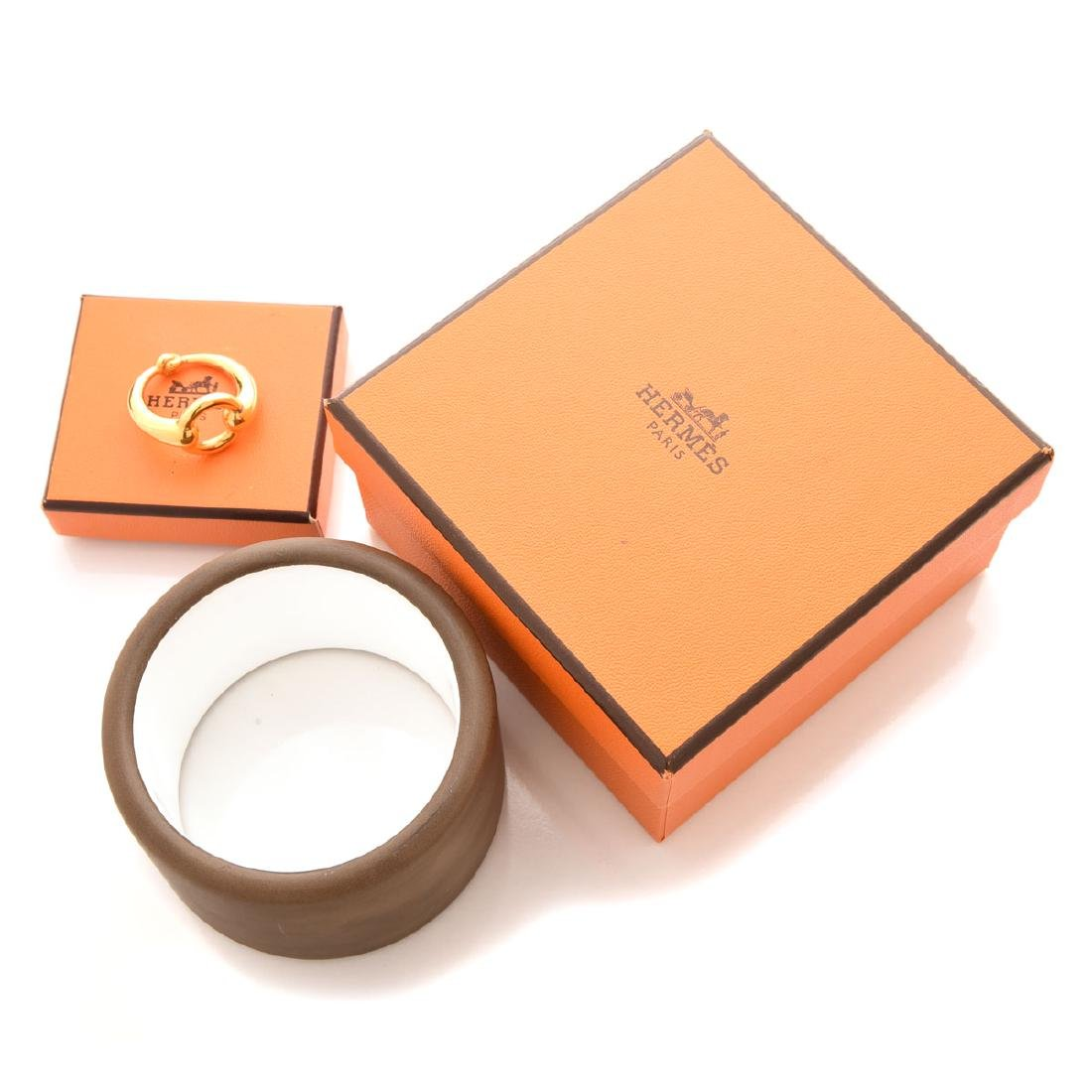 Collection of Hermes Gold-tone Metal, Lucite Jewelry.