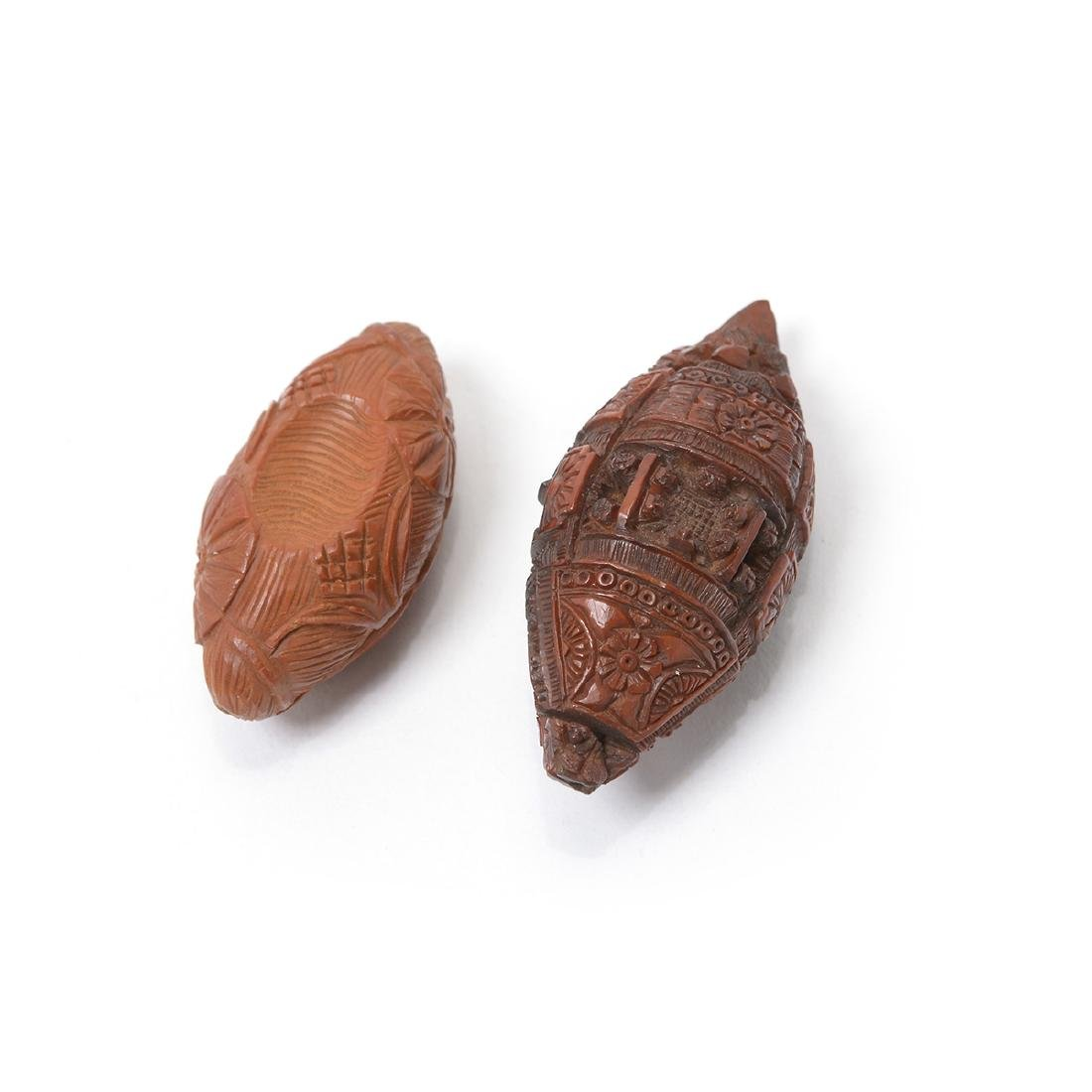 Two Carved Olive Seeds