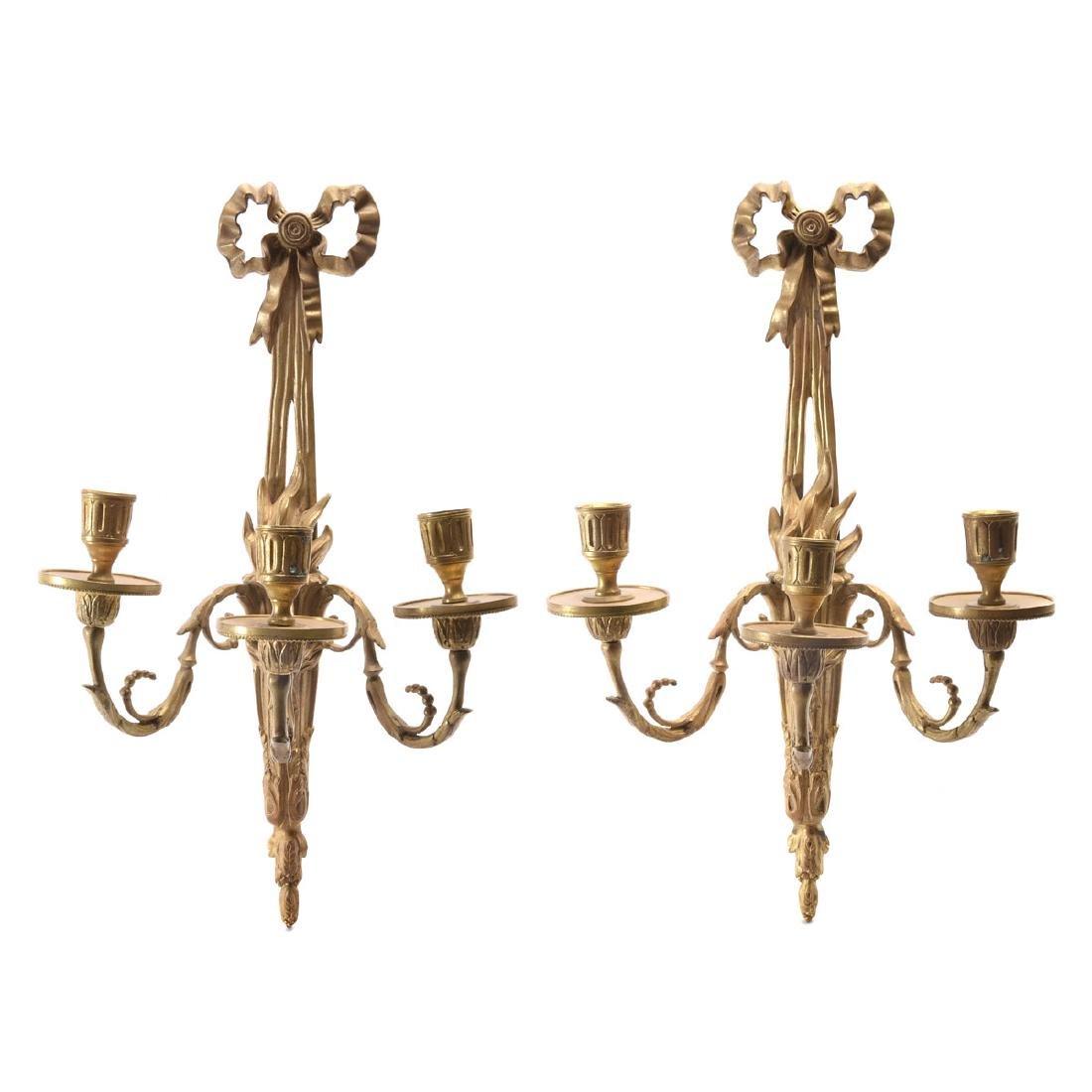 Pair of Louis XVI gilt bronze three light bras de
