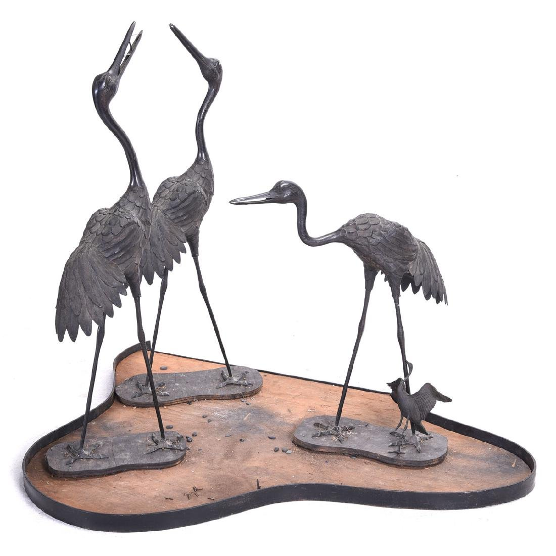 Group of Three Metal Cranes, on Wood and Metal Base