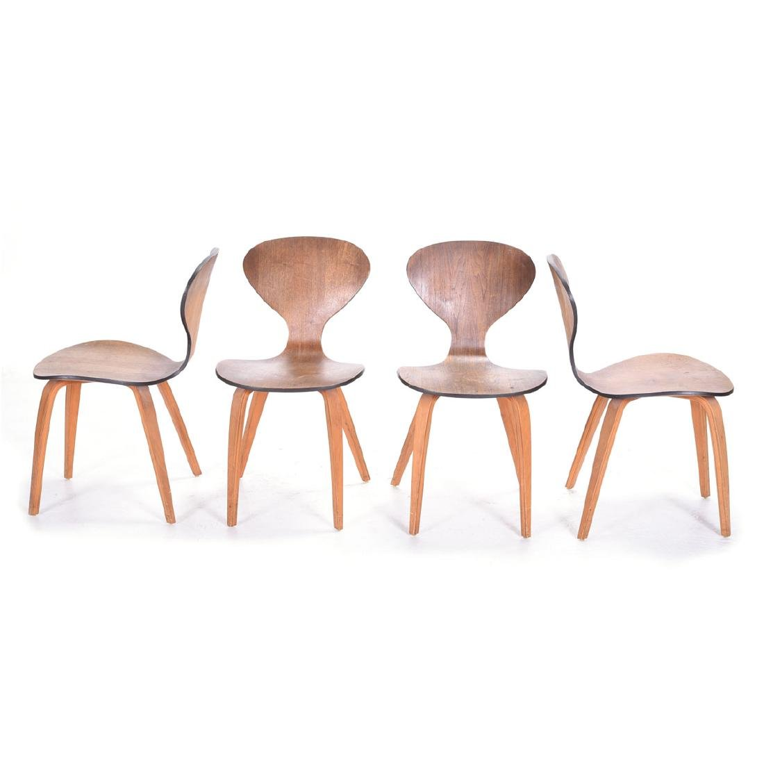 Four Arne Jacobsen Series Seven Chairs.