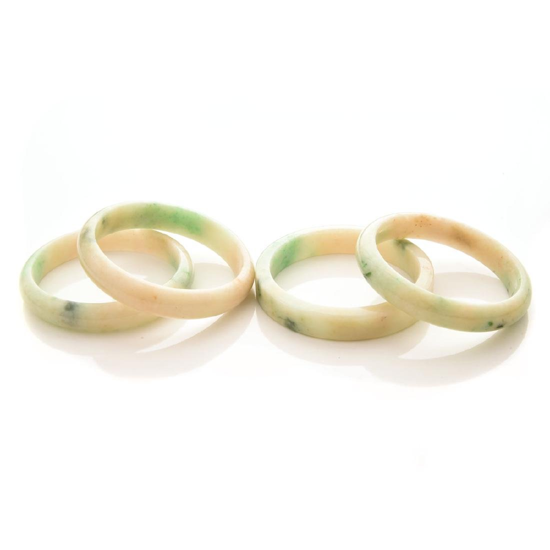 Collection of  Four Jade Bangle Bracelets.