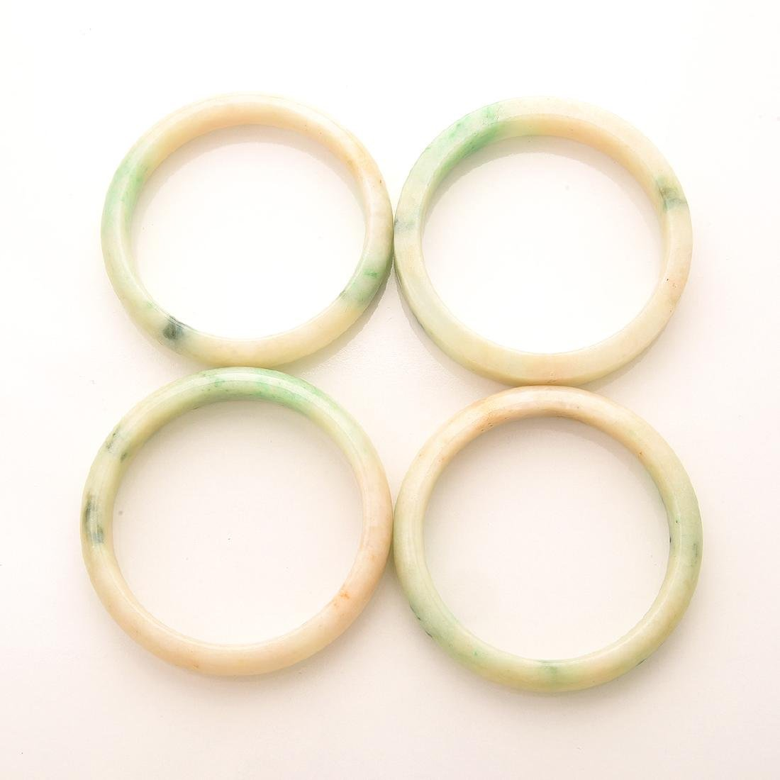 Collection of  Four Jade Bangle Bracelets. - 2