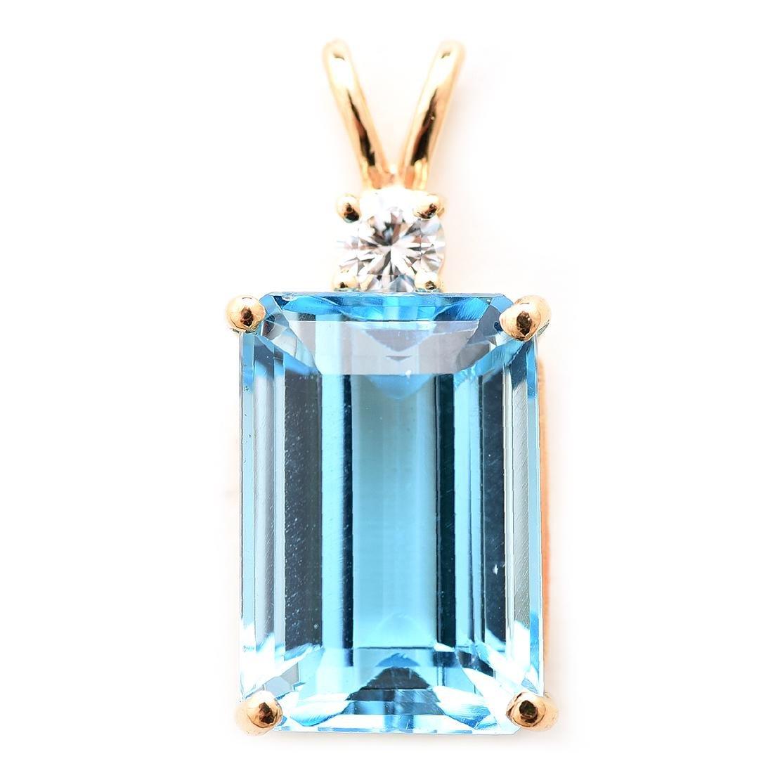 Blue Topaz, Diamond, 14k Yellow Gold Pendant.