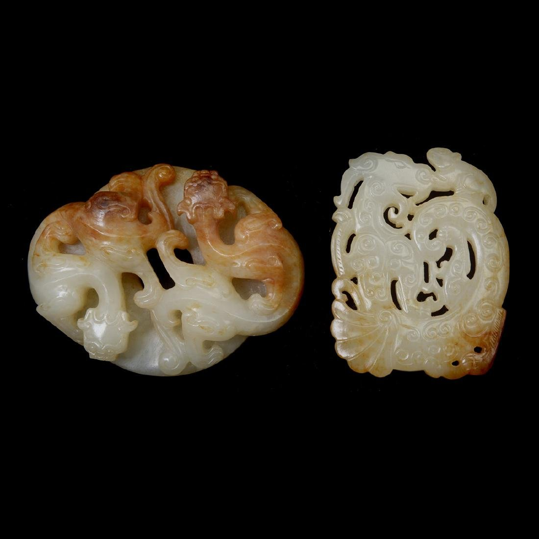 Two Russet Jade 'Dragon' Pendants