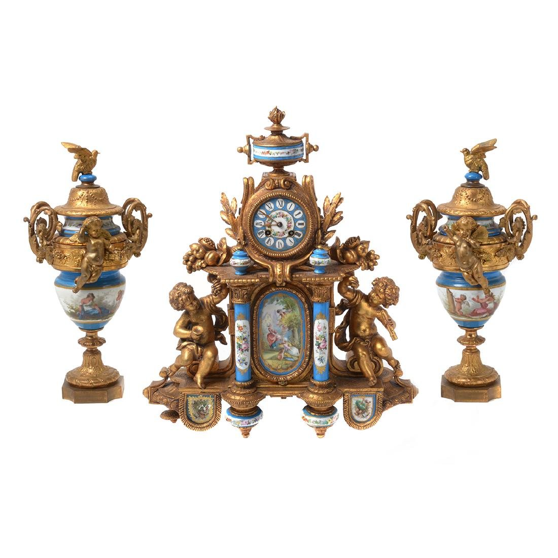 Rococo Style Gilt Metal and Ceramic Clock and Garniture