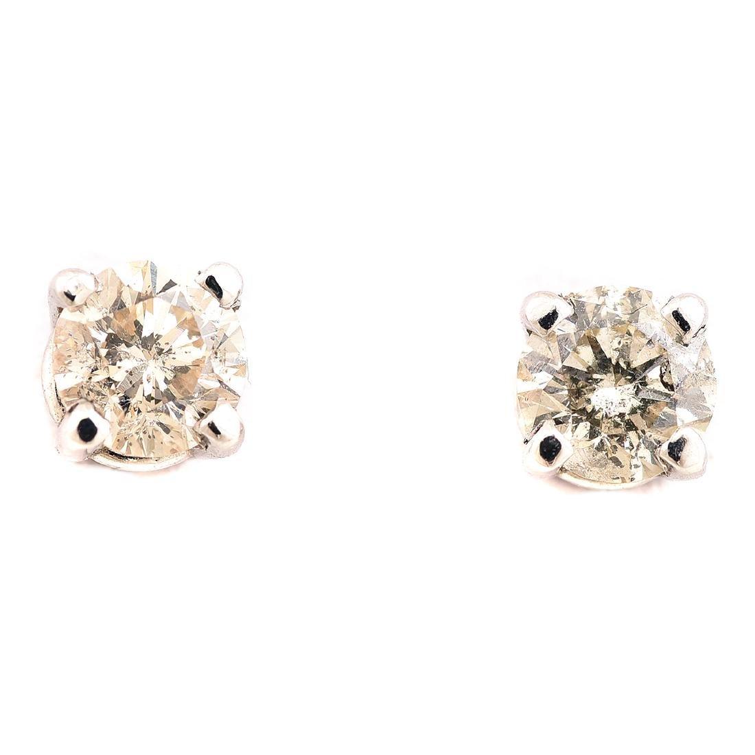 Pair of Diamond, 14k White Gold Stud Earrings.