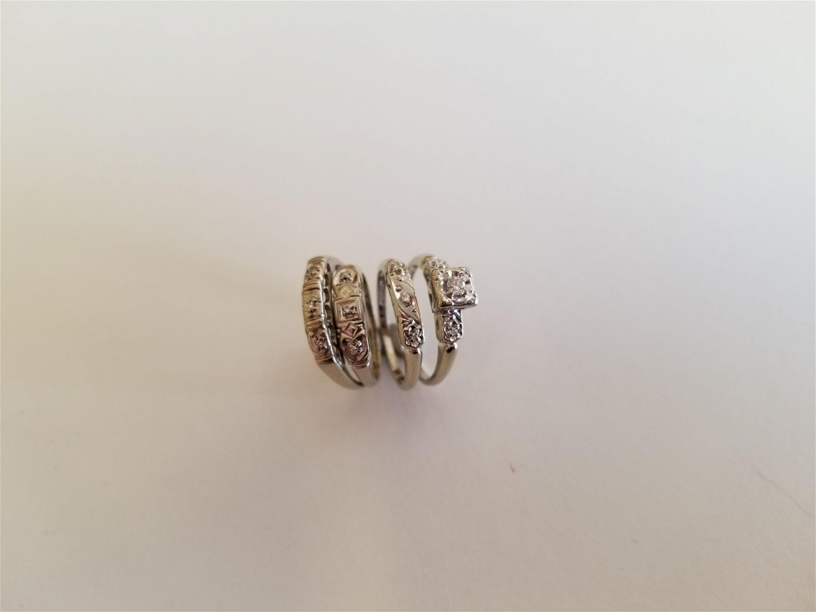 Collection of Four Diamond, White Gold Rings. 4.5 dwts