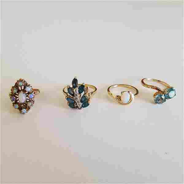 Collection of Four Opal, Blue Zircon, Blue Topaz,
