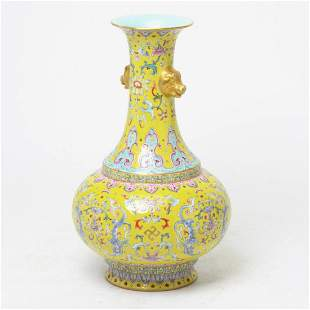 Chinese Lime-Ground Famille Rose Lotus Bottle Vase.
