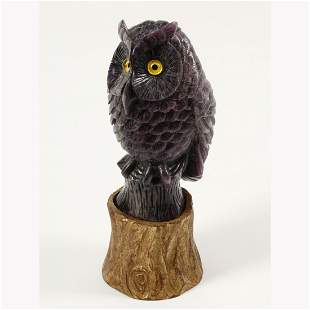 Carved Amethyst Figure of an Owl on Gilt Wood Base.