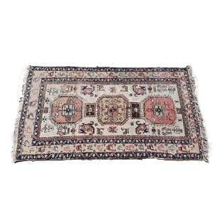 Persian Wool Rug. Three central medallions on a sparse