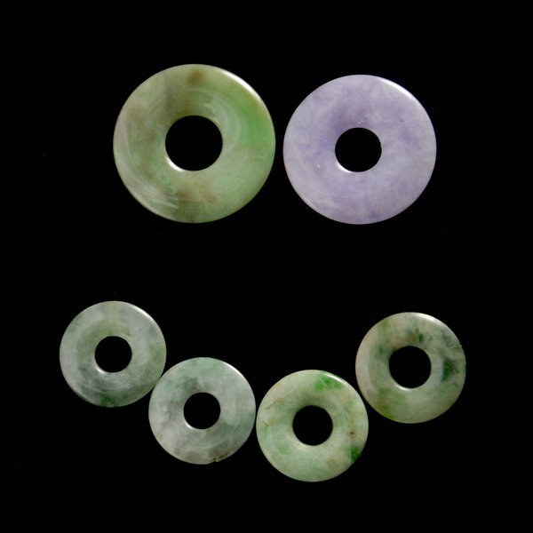 15: COLLECTION OF SIX CARVED JADE DISKS.